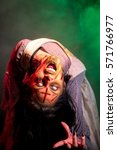 Small photo of Special effects makeup and theatrical lighting bring this possessed girl character to life