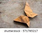 wooden tangram puzzle in flying ...   Shutterstock . vector #571785217