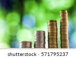 growing coins stacks with green ... | Shutterstock . vector #571795237