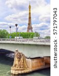 Small photo of Pont de l'Alma (Alma Bridge in English) is a road bridge in Paris across the Seine and Zouave statue and Eiffel Tower.