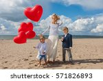 mom with sons celebrate... | Shutterstock . vector #571826893