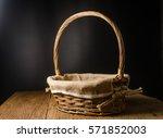 empty wicker basket on wooden... | Shutterstock . vector #571852003