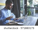 young skilled male freelancer... | Shutterstock . vector #571883173