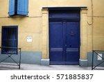 blue old wooden door on yellow... | Shutterstock . vector #571885837
