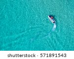 people are playing a jet ski in ... | Shutterstock . vector #571891543