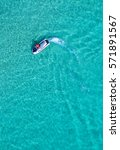 people are playing a jet ski in ... | Shutterstock . vector #571891567