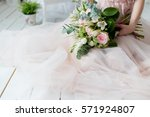 Stock photo beautiful elegant bouquet of roses and greenery in the gentle hands of the beautiful bride girl in 571924807