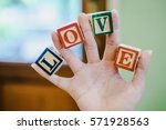 love text word cubical  wooden... | Shutterstock . vector #571928563