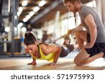 fitness instructor with girl on