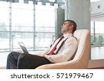 bored businessman stares out... | Shutterstock . vector #571979467
