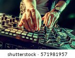 dj playing music at mixer... | Shutterstock . vector #571981957