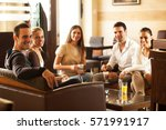 group of friends hanging out at ... | Shutterstock . vector #571991917
