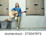 girl musician with acoustic... | Shutterstock . vector #572047873