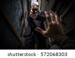 mafia killer murdering an... | Shutterstock . vector #572068303