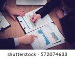 business team hands at working... | Shutterstock . vector #572074633