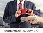 Man Hold Red Heart With Money