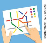hands holding subway map. find... | Shutterstock .eps vector #572123923