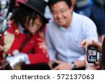 Small photo of HOLLYWOOD - January 21, 2017: Street performer costumed like Michael Jackson takes picture with tourist for tip in front of Michael Jackson's walk of fame star on Hollywood blvd in Hollywood, CA.