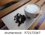 a cup of coffee with flower... | Shutterstock . vector #572172367
