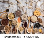 cereals on wooden background | Shutterstock . vector #572204407