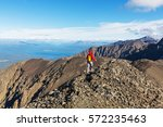 hiking man in canadian... | Shutterstock . vector #572235463
