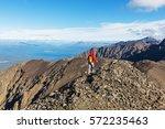 hiking man in canadian... | Shutterstock . vector #572235463
