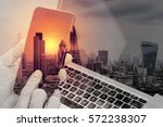Small photo of double exposure of hand using smart phone,laptop, online banking payment communication network technology 4.0,internet wireless application development sync app,London architecture city