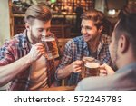 handsome friends are drinking...   Shutterstock . vector #572245783