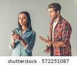 young couple having a quarrel.... | Shutterstock . vector #572251087