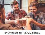 handsome friends are clinking...   Shutterstock . vector #572255587