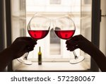 couple drinking wine in a hotel ... | Shutterstock . vector #572280067