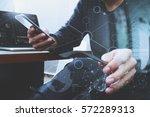 designer hand using mobile