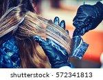 professional hairdresser dyeing ... | Shutterstock . vector #572341813
