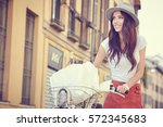 young woman walking with her... | Shutterstock . vector #572345683