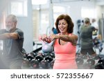senior couple in gym working... | Shutterstock . vector #572355667