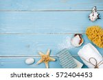 spa and beach products on blue... | Shutterstock . vector #572404453