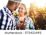 happy people tasting wine in... | Shutterstock . vector #572421493