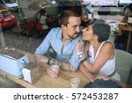 couple in cafe behind the... | Shutterstock . vector #572453287