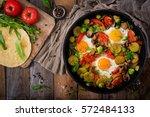 breakfast for two. fried eggs...   Shutterstock . vector #572484133