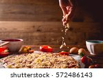 girl is spreading cheese on... | Shutterstock . vector #572486143