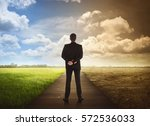 Small photo of Rear view of business man standing between the changing environment. Concept of climate change.