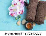 spa set with orchid flower ... | Shutterstock . vector #572547223