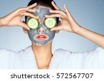 young woman with a clay mask.... | Shutterstock . vector #572567707