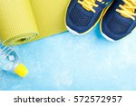 yoga mat  sport shoes and... | Shutterstock . vector #572572957