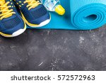 yoga mat  sport shoes and... | Shutterstock . vector #572572963