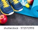yoga mat  sport shoes  apples ... | Shutterstock . vector #572572993