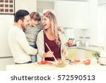 happy family preparing meal... | Shutterstock . vector #572590513