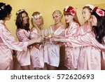 bride and bridesmaids in silk... | Shutterstock . vector #572620693