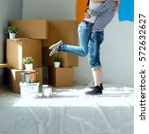 happy young couple moving in... | Shutterstock . vector #572632627