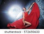 Small photo of Stunning beautiful brunette posing against moonlight